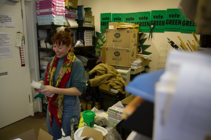 Zara smiling packing campaign leaflets in a store rom